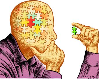 picture of man's head made of puzzle pieces and he is holding a puzzle piece