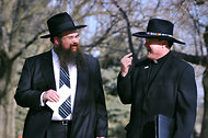 Rabbi Shais Taub, left, and Rev. Steven E. Boes, Boys Town's president, spoke with each other after a meeting.
